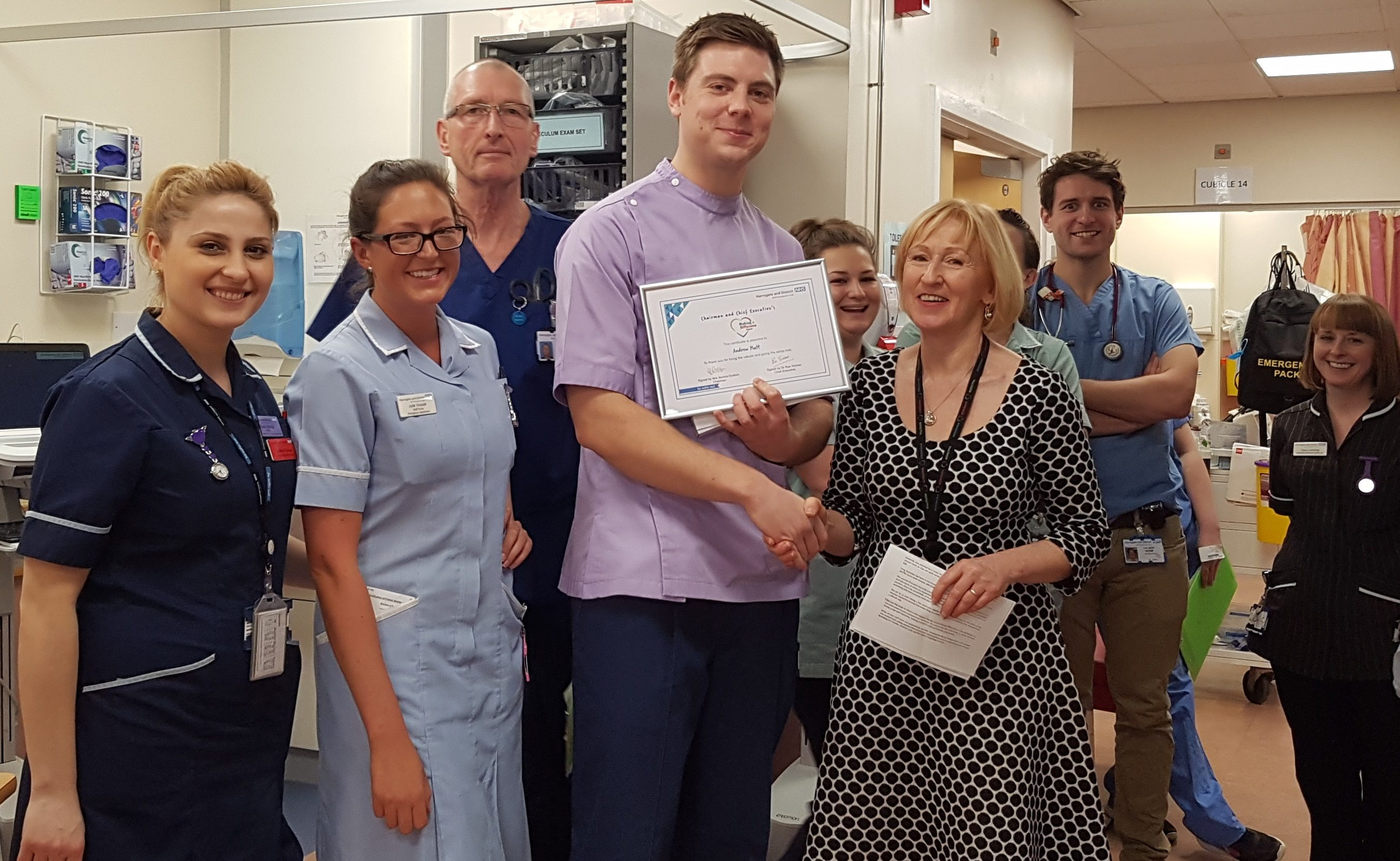 Pictured - Andrew Platt with colleagues from the Emergency Department and Mrs Sandra Dodson, Chairman