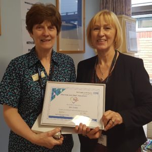 Ann Evans collecting her making a difference award