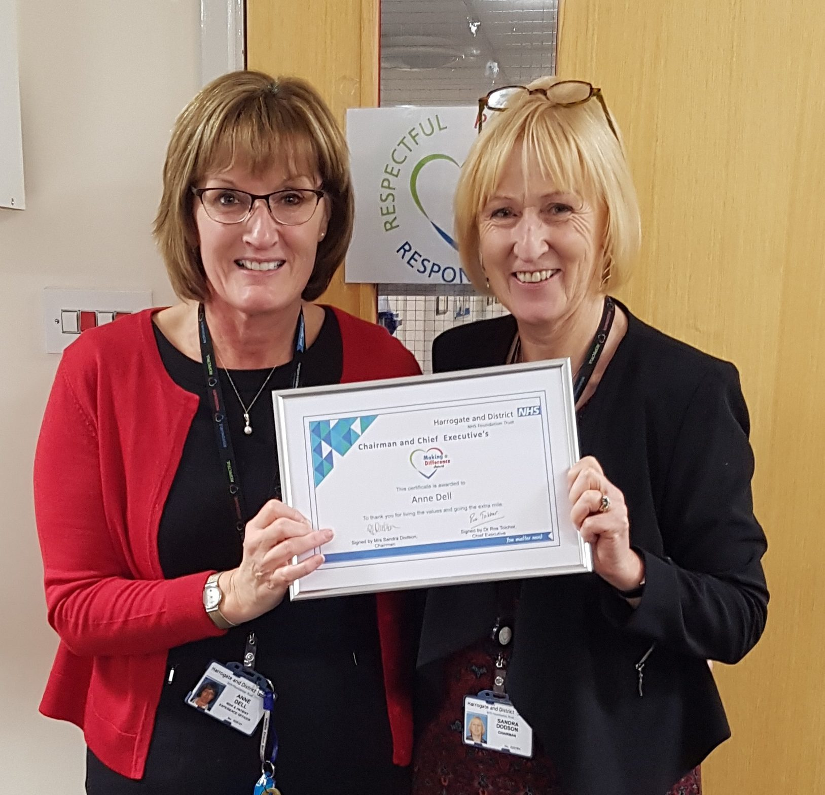 Anne Dell collecting her making a difference award