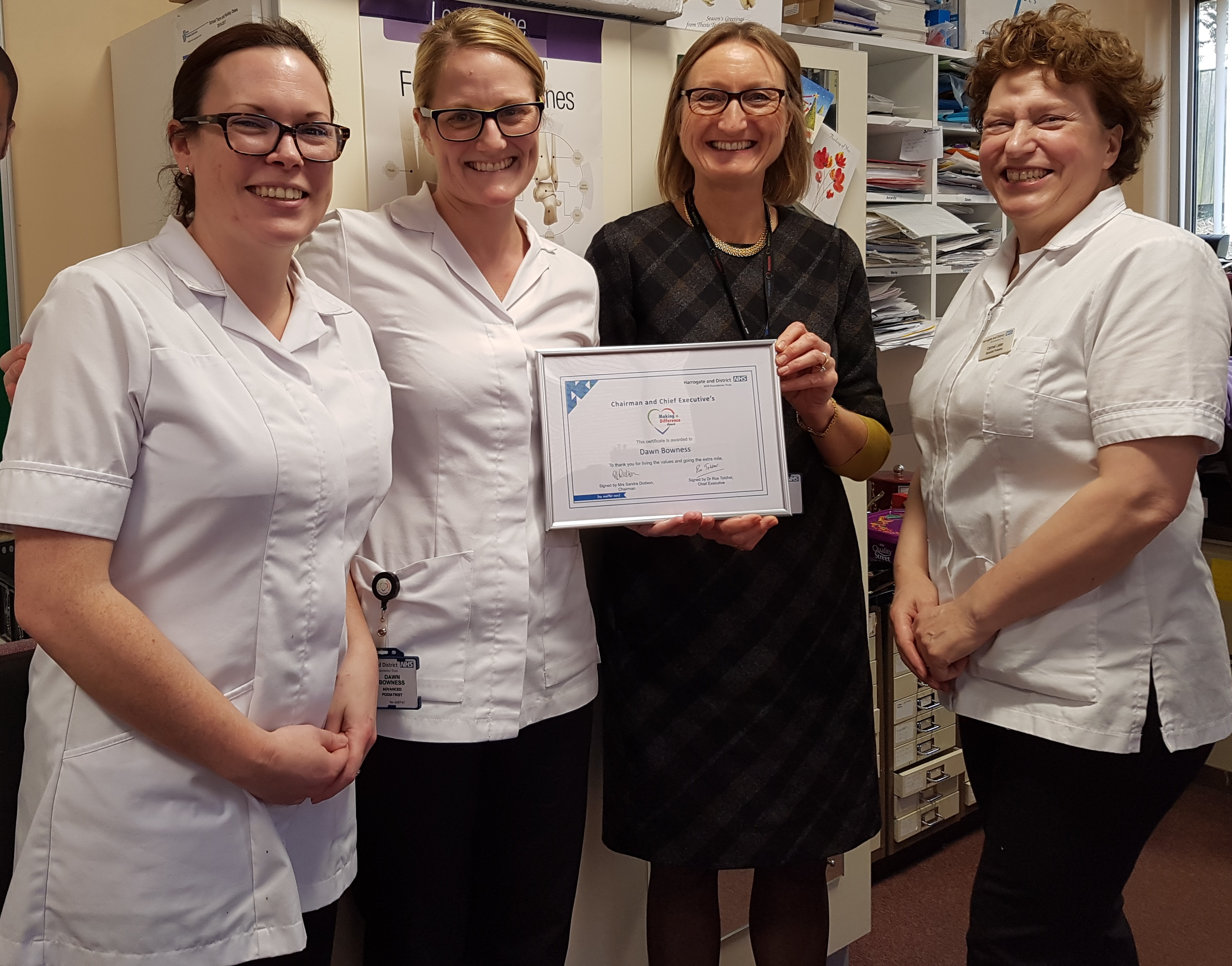 Dawn Bowness pictured with Dr Ros Tolcher, Chief Executive and Podiatry colleagues, Emma Noe and Carmel Lister