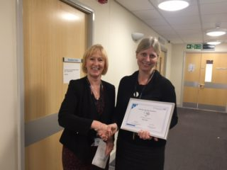 Di Fisher receiving her making a difference award