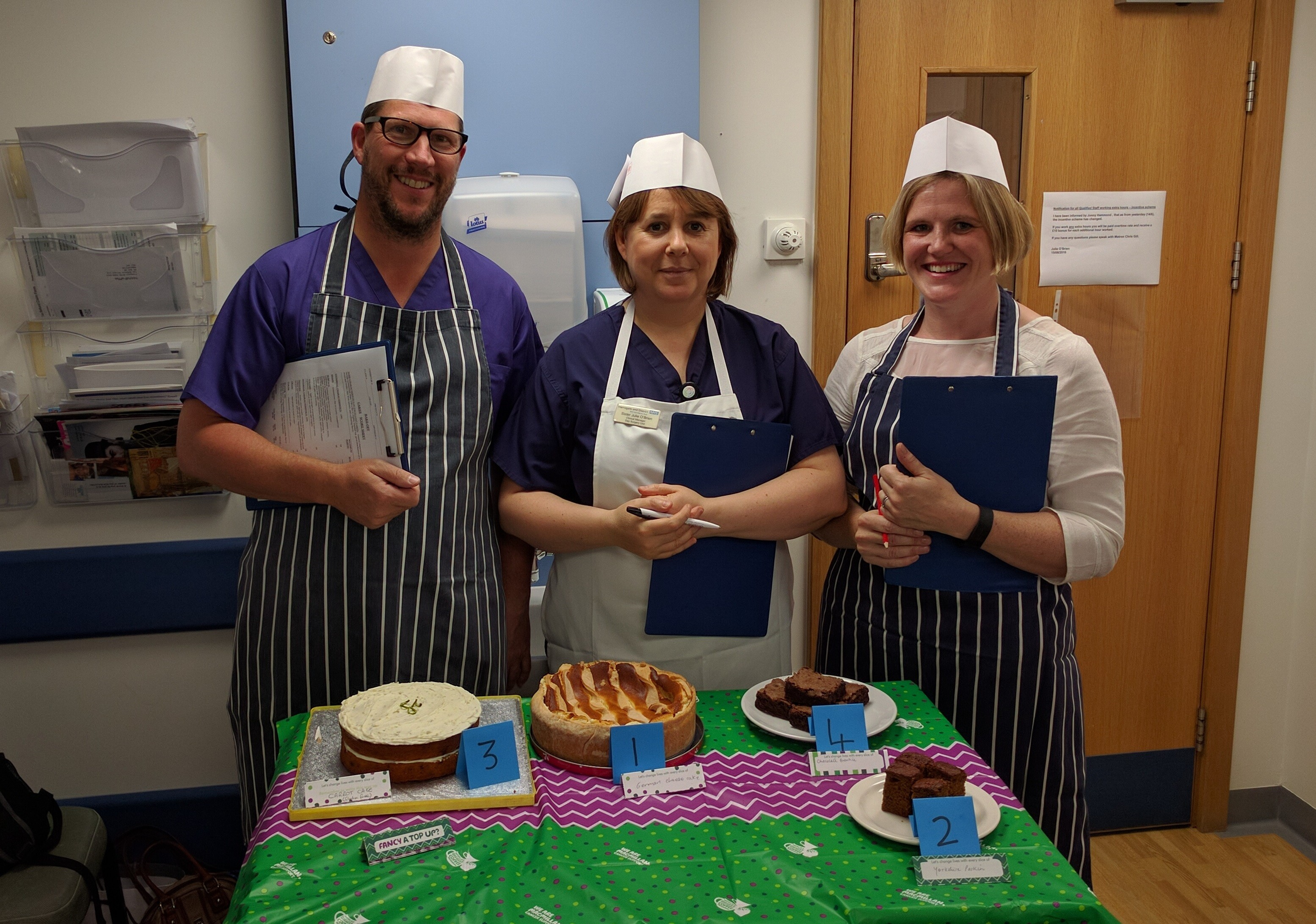 Sampling the delights - Staff play the part of Bake Off judges in best cake competition.